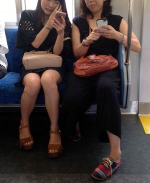 My shot inwards of the train, up mini-skirt voyeur. Japanese girl