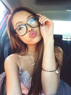 Beautiful asian girls take selfies in the car