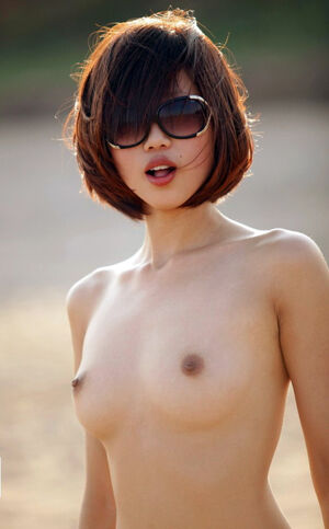Charming big tits asian housewife with pigtails walks naked on the field
