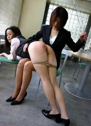 Asian woman teacher spanks japanese schoolgirl