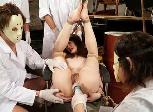 Japanese slut was banged by some toys in brutal BDSM orgy.